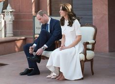 William and Kate remove their shoes before touring the museum housed in the Old Birla House