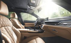 Interior of the BMW ALPINA B7 xDrive Sedan with exclusive Cognac Nappa leather seats.