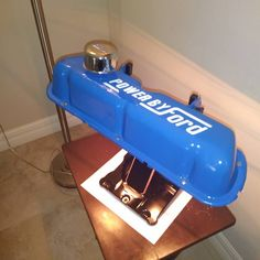 Another look at desk lamp. Made from used vintage Ford valve cover and Harley Davidson upper rocker box cover Car Part Furniture, Automotive Furniture, Automotive Decor, Bookshelves With Tv, Industrial Shop, Industrial Bookshelf, Industrial Windows, Car Part Art, Hobby Desk