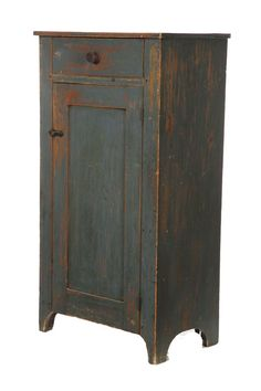 blue cupboard with drawer and flat-panel door. Hard to tell from this picture, but the door and drawer are wrapped with a bead. Typically called a cock-bead or quirk-bead. And some just call it a Shaker bead because it's similar to the detail found on a Shaker Peg Rail. Nice color and aging. -CW-