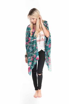Perfect for the cooler fall days, our Mindy kimono looks great over a graphic tee and distressed denim. Product Details: 100% Polyester Hand Wash Cold or Dry Cl