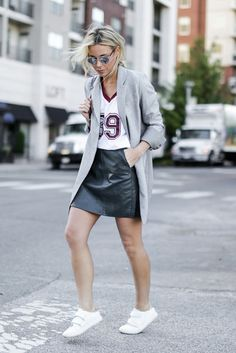 justthedesign:  Mary Sengwears a leather mini skirt with a smart grey overcoat and casual white sneakers.Jacket: McGinn, Top: Anine Bing, Skirt/Sneakers: Zara.