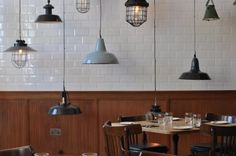 The interiors of Viajante in London feature a mix of reclaimed vintage industrial lights.