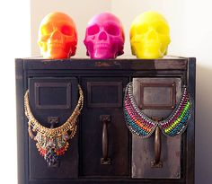 LOVE! Gorgeous multi colored necklaces (and skull candles)
