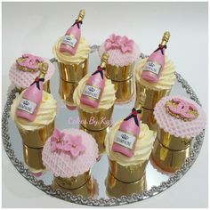 Pink Champagne Cupcakes. Champagne bottles made from fondant #pinkchampagnecupcakes