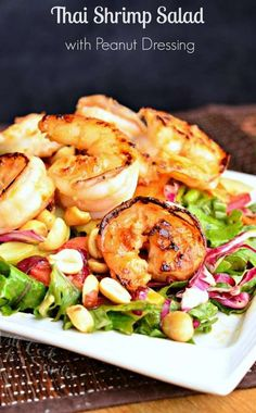 Thai Shrimp Salad with Peanut Dressing. It's made with juicy, seared shrimp flavored with honey, garlic and ginger, on top of a vegetable mixture dressed with easy, homemade peanut dressing. | from willcookforsmiles.com