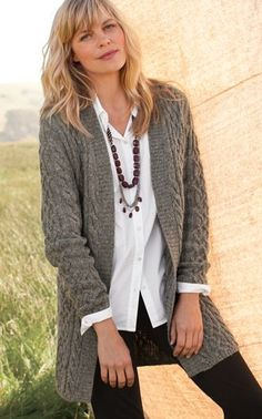 Long chunky cardigan, long necklaces, leggings. Try a chambray shirt.
