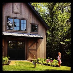 Love the wood and black in this, with some grayish colour rammed earth.. =beautiful! Converted barns <3
