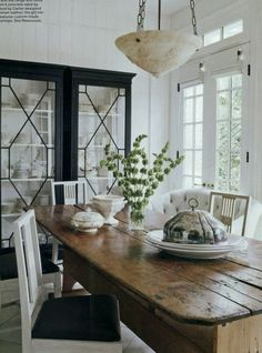 Dining room in Elle Decor, designed by Darryl Carter. (our french door with transom window, our farm table.) From Mark D. Rustic Farm Table, Farmhouse Table, Wood Table, Rustic Wood, Farm Tables, French Farmhouse, Timber Table, Pine Table, Coastal Farmhouse
