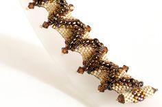 Seed Bead Bracelet in Smoked Topaz Crystals, Brown and Ivory Seed Beads - Beaded Bracelet - Peyote Bracelet - Flat Cellini by KKbraceletsandmore on Etsy https://www.etsy.com/listing/206928087/seed-bead-bracelet-in-smoked-topaz