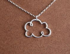 Cute little cloud necklace. For when you've got a dark cloud hanging over your head. (literally or figuratively)
