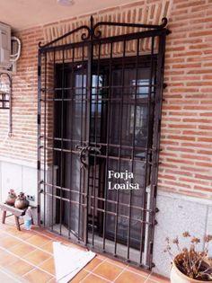 Puerta rejas Castellana.