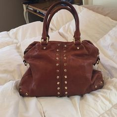Michael Kors satchel/bowling bag camel/brown colored gold studded (on both sides) easy to wear on your arm or fits on shoulder, 5 inside pockets (one that zips shut) still VERY clean inside shows no wear Michael Kors Bags Satchels