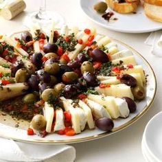 Marinated Olive & Cheese Ring Recipe from Taste of Home -- shared by Patricia Harmon of Baden, Pennsylvania (Fruit And Cheese Platter) Finger Food Appetizers, Yummy Appetizers, Appetizers For Party, Finger Foods, Appetizer Recipes, Cheese Appetizers, Tapas, Marinated Olives, Marinated Cheese