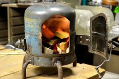 Martiens Bekker shared this image of a tiny wood stove made from a former gas tank. Adaptive reuse!