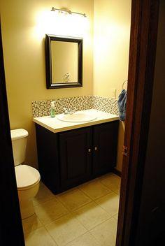 Love this tiled backsplash in the bathroom