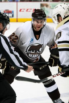 01.26.14 - Hershey Bear, Ryan Potulny, with a tongue shot during face off.  Photo courtesy of JustSports Photography