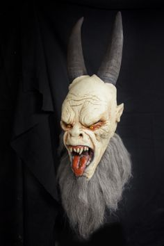 Christmas Krampus Anti Santa Demon Devil Monster Creature Halloween Mask.  This realistic Halloween mask is based on a dark little Christmas story and legendary tale told in many countries of this scary Demon beast known as Krampus, the Anti Santa.  $75.00 free U.S. Shipping.
