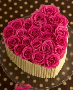 'Rose Chocolate Heart' birthday cake.  Chocolate fudge cake, Fortnum's rose petal jelly, Amedei Toscano chocolate ganache buttercream, white chocolate curls, fresh roses.