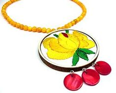 Hand embroidered jewellery with yellow flower  by Andrea Macsar http://www.h-art.com.au/#!necklaces/c1y06