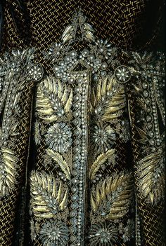 Man's Court Suit French 1785-92  Silk cut and uncut figured velvet embroidered with gilt silver wire, sequins, and bits of glass