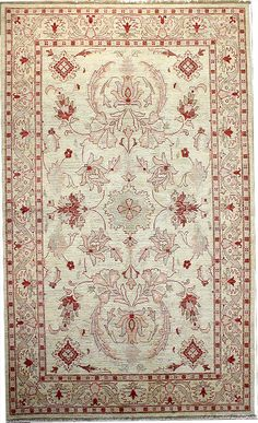 This is a beautiful hand-knotted area rug made with 100% fine wool. With the light colors ivory and rose, this oriental rug will compliment any room. Although this is a traditional area rug, the Ziegler design compliments both a traditional and contemporary décor.
