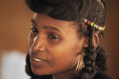 Africa | Young Wodaabe woman.  Niger | ©Steve Evans.