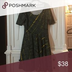 Euc xl LuLaRoe Nicole dress Worn once hand wash this stunning grey & yellow Nicole dress is from LuLaRoe. Thicker quilted Cassie fabric with tons of stretch. Smoke free pet free home Dresses