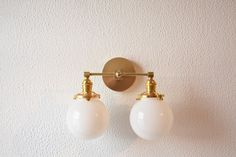 Free Shipping! Wall Sconce Vanity Gold Brass 2 Bulb With White Opal Globes Modern  Mid Century Industrial Art Light Bathroom UL Listed by IlluminateVintage on Etsy https://www.etsy.com/listing/477369389/free-shipping-wall-sconce-vanity-gold