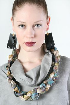 leather earrings and a braided necklace, Skin of the Night -collection    by Piia Myller
