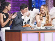 Stephen Colbert Uses Victoria's Secret Angel Wings as a Chicken Wings Napkin and More Must-See Angel Appearances http://stylenews.peoplestylewatch.com/2015/12/08/victorias-secret-angels-cute-tv-appearances/