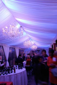 Lights - covered by linen drapery. #aspecialtouch #beautiful #event #decor