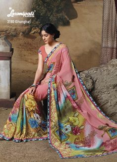 Peach Georgette saree is decorating with jewels printed lace & floral prints.