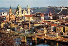 "Passau, Germany, showing St. Paul's Church (left) and the cathedral (left centre). Passau is a town in Lower Bavaria, Germany. It is also known as the Dreiflüssestadt or ""City of Three Rivers,"" because the Danube is joined at Passau by the Inn from the south and the Ilz from the north."