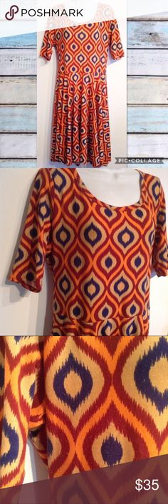 """LULAROE Nicole Orange Earth Tone Print Dress Lularoe orange, blue, and maroon geometric print Nicole dress. Perfect colors for autumn. Cropped sleeves. Fitted at the waist. Flowy flattering bottom. Minor piling under arms. Soft and stretchy. Size 2XL. Measures 22"""" flat from armpit to armpit and 42"""" long. No modeling. Smoke free home. I do discount bundles. LuLaRoe Dresses"""