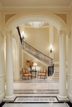 Staircase with turn, additional steps. classical interior with columns and arched doorways. Foyer Staircase, Staircase Design, Stairs, Staircases, Staircase Ideas, Iron Staircase, Staircase Remodel, Foyer Ideas, Decor Ideas