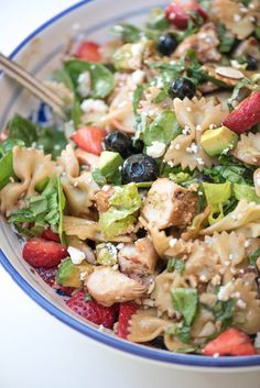 This salad includes a little bit of everything you need for a complete nutritious meal. Fresh greens, gorgeous, ripe berries, lean protein, pasta, and more all dressed in a honey balsamic dressing. Delicious! ~ http://www.fromvalerieskitchen.com