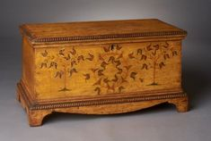 A MINIATURE DECORATED CHEST.