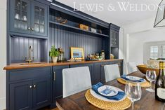 """This classic coastal wet bar finished in Benjamin Moore """"Abyss"""" Bar Cabinet Furniture, Wet Bar Cabinets, Built In Bar, Custom Kitchens, White Rooms, Custom Cabinetry, Bath Design, Traditional Design, Kitchen And Bath"""