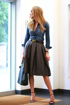 chambray top, gray pleated skirt, black belt, black strappy heels, black tote