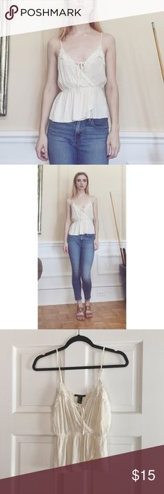 Cream surplice top This flattering top has some cute crochet detailing at the top. Pair it with jeans and sandals for a cute & casual look. Forever 21 Tops Blouses