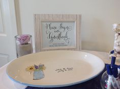 Have guests sign a custom platter that you can use afterwards.  Jen and Dan Keating 7.18.15