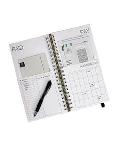 """Keep those resolutions to never be late with bills again! This """"Dated Bills Calendar"""" keeps paper (and envelopes!) in the appropriate pockets, and has a handly list side and calendar side, for stuff you just have to write down. Like a mini-desk! An investment in efficiency at $32 from redstarink.com."""