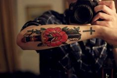 Forearm tattoo dagger and rose