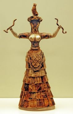 "Minoan: Snake Goddess, from the palace at Knossos. c. 1600 BCE. Faience, appx. 13 1/2 "" H. Archeological Museum, Herakleion. Aside from images of bulls, the only obvious deity we have from ancient Crete is the so-called Snake Goddess, perhaps an Earth Goddess who is holding two snakes in her outstretched hands - she is shown with aflounced skirt, and open bodice (evidently standard among Minoan women), and a dove perched on her head which signifies her being divine."