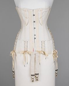 Corset H & W Company Date: ca. 1908 Culture: American Medium: cotton, bone, metal, elastic Dimensions: Length at CF (a, b): 16 in. (40.6 cm)...