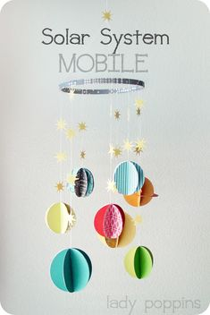Max's Room: Lady Poppins DIY Solar System mobile using an old embroidery hoop. Planets and stars made from paper. Solar System Mobile, Diy Solar System, Sistema Solar 3d, Galaxy Party, Solar System Projects For Kids, Solar System Activities, Planet Mobile, Systems Art, Diy And Crafts