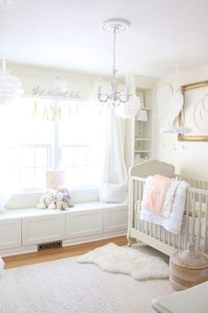 A great way to add depth to a white nursery is to use various textures and shades!