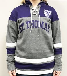 Perfect addition for any Tommie fan's wardrobe. This hockey hood has a lace up chest with purple tackle twill letters & a athletic shield on front. 60% cotton 40% polyester ($59.99) Maine, Hoodies, Sweatshirts, Hockey, Graphic Sweatshirt, Lace Up, Letters, Athletic, Purple