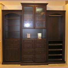 Beautiful cupboard featuring tempered glass inserts and Decore doors and drawer fronts Belt Rack, Rta Cabinets, Custom Closets, Closet System, Crown Molding, Drawer Fronts, Cabinet Doors, Fences, Cupboard